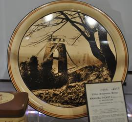Round cream tin tray or plate decorated with printed image of Clifton Suspension Bridge