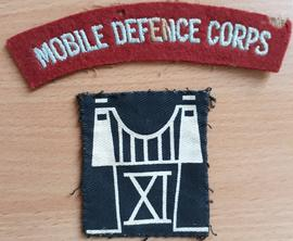 Shoulder badge for the 11th (Bristol & Glos) Mobile Defence Corps, with flash showing Clifton...