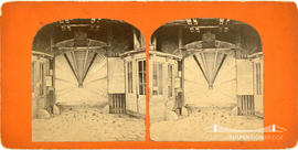 Stereoview of entrance to the walkway under the railway suspension bridge at Niagara Falls