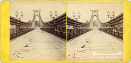 Stereoview of Clifton Suspension Bridge showing pedestrians on the carriageway taken from the cen...