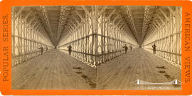 Stereoview showing wooden carriageway under the railway suspension bridge at Niagara Falls