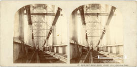 Stereoview of the Royal Albert Bridge, Saltash showing figures on the railway under the suspendin...