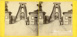 Stereoview of Clifton Suspension Bridge showing worker standing by the Leigh Woods toll houses