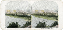 Stereoview of an army crossing a bridge