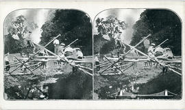 Stereoview of army engineers constructing a temporary bridge to carry lorries across a river