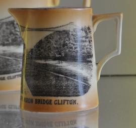Cream coloured milk jug decorated with a transfer image of Clifton Suspension Bridge