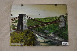 Reverse glass gilded and painted picture of Clifton Suspension Bridge decorated with pieces of mo...