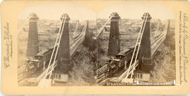 Stereoview of the railway suspension bridge at Niagara Falls showing a steam train on the Erie ra...