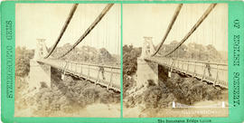 Stereoview of Clifton Suspension Bridge showing pedestrian looking over the parapet and with the ...
