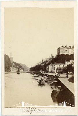 Photograph showing passengers boarding ferry with the towers of Clifton Suspension Bridge visible...