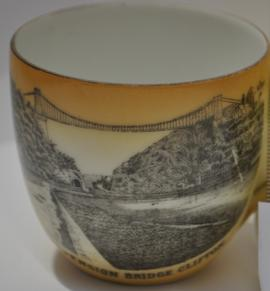 Cream coloured cup decorated with a transfer image of Clifton Suspension Bridge