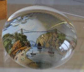 Glass paperweight decorated with reverse painted image of Clifton Suspension Bridge