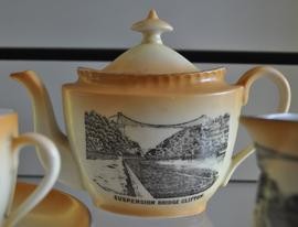 Cream oval teapot decorated with a transfer image of Clifton Suspension Bridge