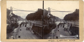 Stereoview showing passengers boarding steamboat with Clifton Suspension Bridge