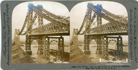 Keystone View Company stereoview of the New East River Bridge, New York under construction