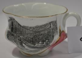 White and pink cup and saucer with a transfer print of Clifton Suspension Bridge