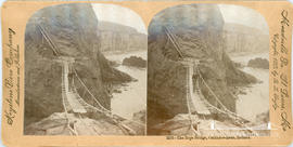 Keystone View Company stereoview of the rope bridge at Carrick-A-Rede, Ireland
