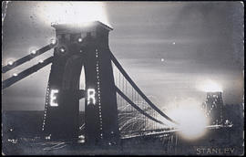 Postcard showing the Clifton Suspension Bridge illuminated for the visit of King Edward VII in 1908