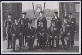 Postcard showing the bridge attendants posed on the Suspension Bridge